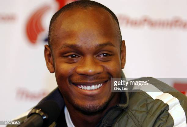 Asafa Powell of Jamaica the world record holder in the 100 meters at the 112th Penn Relays USA vs The World press conference at the Dunning Center at...