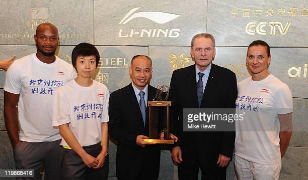 Asafa Powell of Jamaica Zhang Yining of China Li Ning Chairman of Li Ning Yelena Isinbayeva of Russia and IOC President Jacques Rogge pose for...