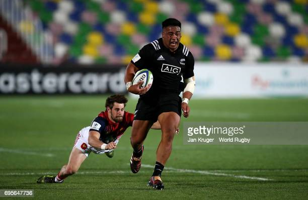 Asafo Aumua of New Zealand shows a clean set of heals past Arthur Retiere of France during the World Rugby via Getty Images U20 Championship semi...