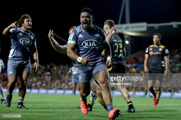 Asafo Aumua of the Hurricanes celebrates after scoring a try during the round seven Super Rugby match between the Chiefs and the Hurricanes at...