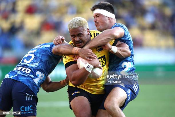 Asafo Aumua of the Hurricanes charges forward to score a try during the round one Super Rugby Aotearoa match between the Hurricanes and the Blues at...
