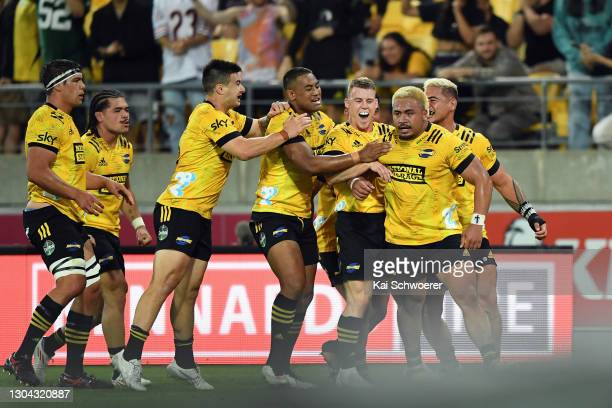 Asafo Aumua of the Hurricanes is congratulated by team mates after scoring a try during the round one Super Rugby Aotearoa match between the...