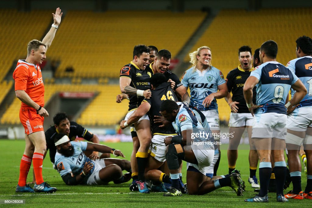 Asafo Aumua of Wellington celebrates with Carlos Price and Alex Fidow after scoring a try during the round nine Mitre 10 Cup match between Wellington and Northland at Westpac Stadium on October 12, 2017 in Wellington, New Zealand.