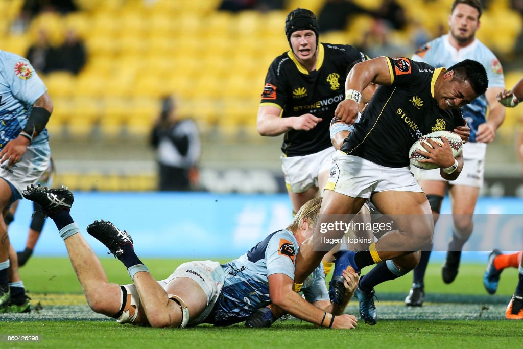 Asafo Aumua of Wellington is tackled by Josh Goodhue of Northland during the round nine Mitre 10 Cup match between Wellington and Northland at Westpac Stadium on October 12, 2017 in Wellington, New Zealand.
