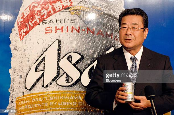 Asahi Breweries Ltd President Kouichi Ikeda speaks to reporters while holding a can of the companies' new beer 'Asahi ShinNama' at a press briefing...