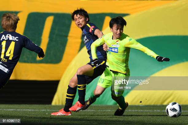 Asahi Yada of JEF United Chiba and Shinnosuke Nakatani of Kashiwa Reysol compete for the ball during the preseason friendly match between JEF United...