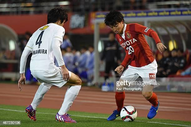 Asahi Yada of Nagoya Grampus tries to beat Kazuya Yamamura of Kashima Antlers during the J.League match between Nagoya Grampus and Kashima Antlers at...