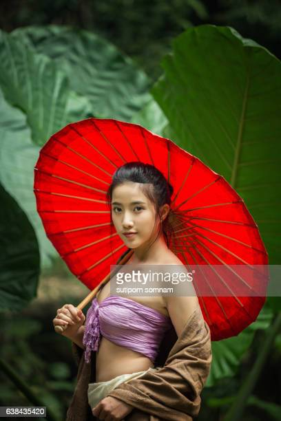 Asain woman holding red umbrella