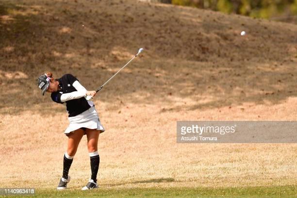 Asako Fujimoto of Japan hits her second shot on the 1st hole during the final round of the Yamaha Ladies Open Katsuragi at Ktsuragi Golf Club Yamana...