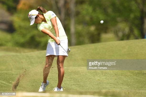 Asako Fujimoto of Japan hits her second shot on the 8th hole during the final round of the CyberAgent Ladies Golf Tournament at the Grand Fields...