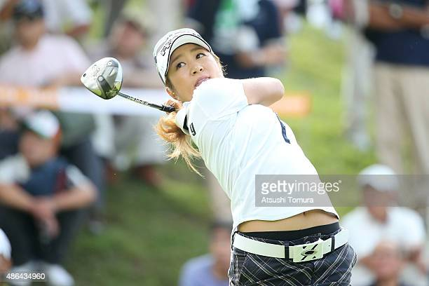 Asako Fujimoto of Japan hits her tee shot on the 1st hole during the first round of the Golf 5 Ladies Tournament 2015 at the Mizunami Country Club on...