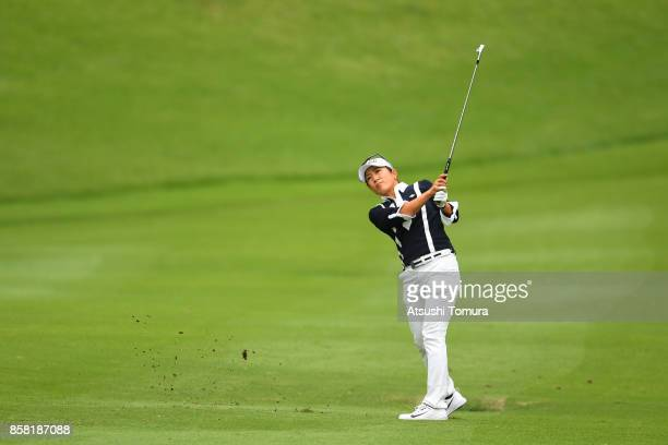 Asako Fujimoto of Japan hits her third shot on the 18th hole during the first round of Stanley Ladies Golf Tournament at the Tomei Country Club on...
