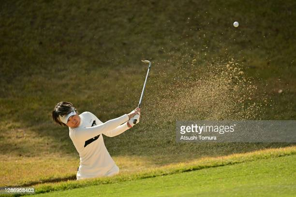 Asako Fujimoto of Japan hits out from a bunker on the 6th hole during the final round of the Daio Paper Elleair Ladies Open at the Elleair Golf Club...