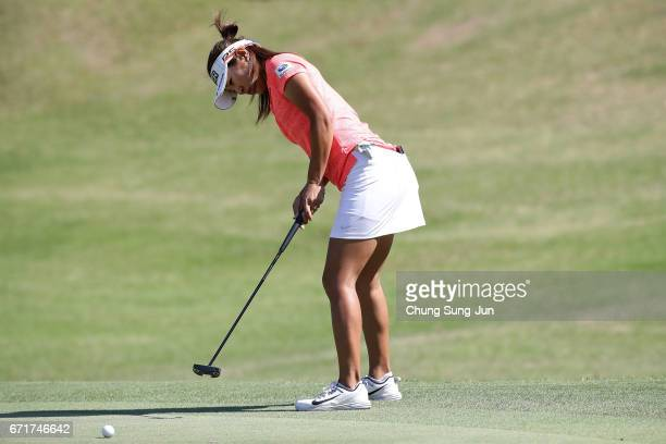 Asako Fujimoto of Japan plays a putt on the 16th green during the final round of Fujisankei Ladies Classic at the Kawana Hotel Golf Course Fuji...