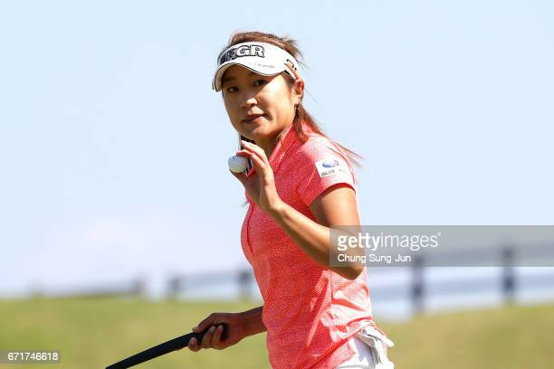 Asako Fujimoto of Japan reacts after a putt on the 16th green during the final round of Fujisankei Ladies Classic at the Kawana Hotel Golf Course...