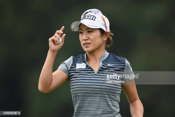 Asako Fujimoto of Japan reacts after her putt on the 18th green during the first round of the Munsingwear Ladies Tokai Classic at Shin Minami Aichi...