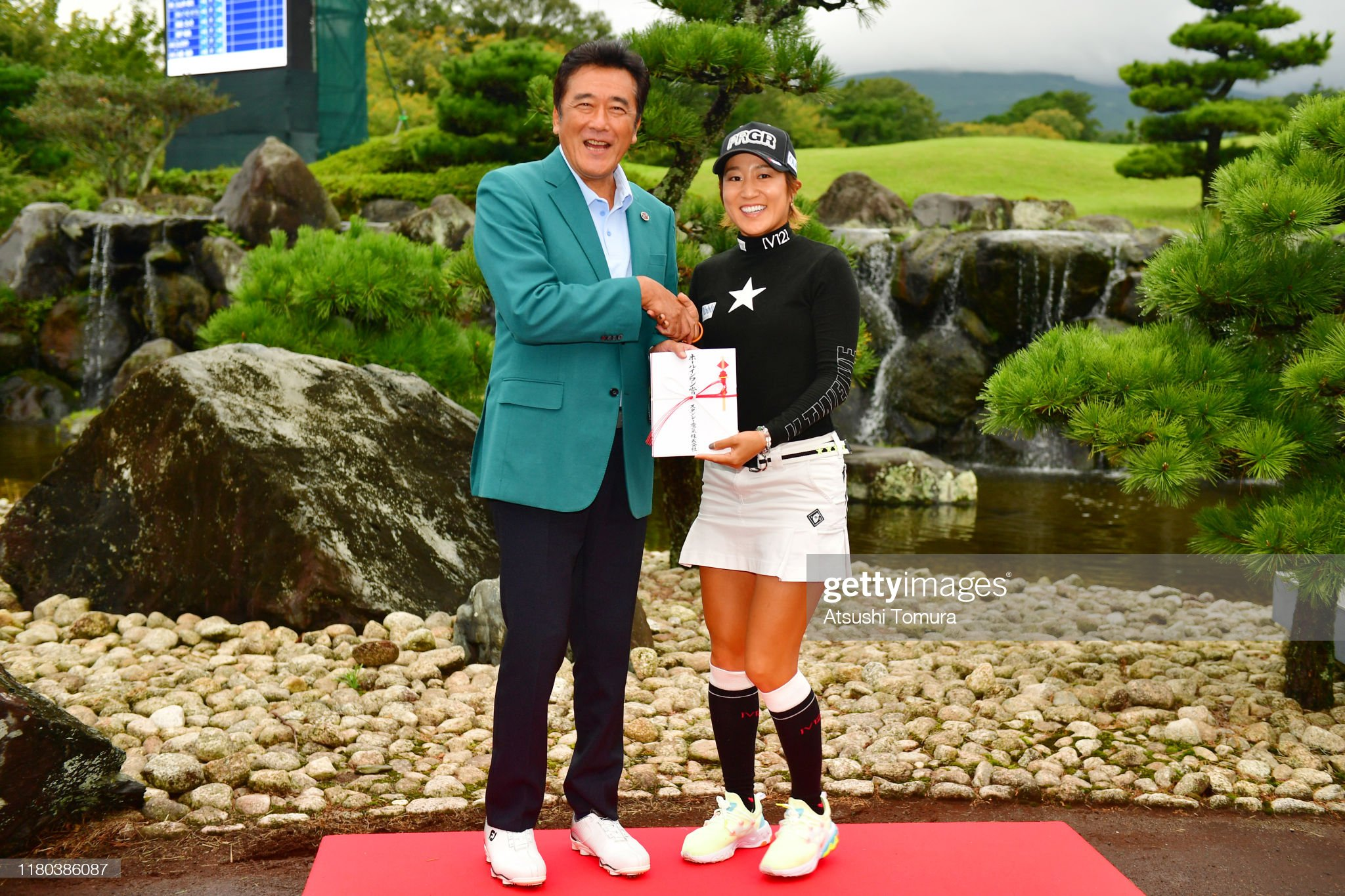 https://media.gettyimages.com/photos/asako-fujimoto-of-japan-shakes-hands-with-stanley-electric-co-ltd-picture-id1180386087?s=2048x2048