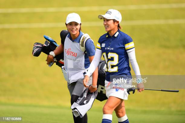 Asako Fujimoto of Japan talks with her caddie on the 10th hole during the final round of Fujitsu Ladies at Tokyu Seven Hundred Club on October 20...