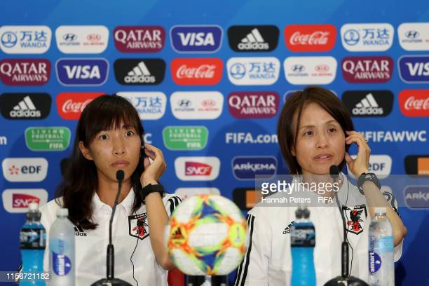Asako Takakura head coach of Japan and Emi Nakajima of Japan listen to translators during a press conference at Stade de Nice on June 18 2019 in Nice...