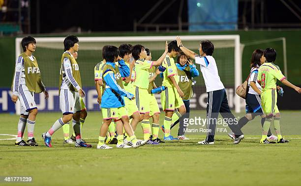 Asako Takemoto Takakura head coach of Japan celebrate after the FIFA U17 Women's World Cup 2014 semi final match between Venezuela and Japan at...