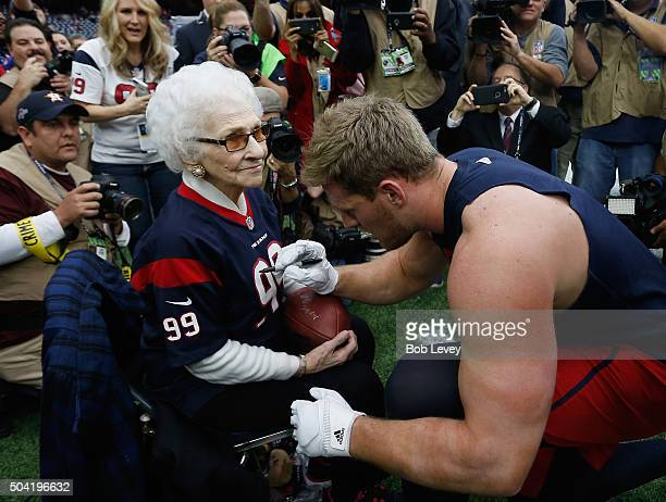 Asalee Poole who turned 99 on New Year's Eve meets JJ Watt of the Houston Texans before they play against the Kansas City Chiefs during the AFC Wild...