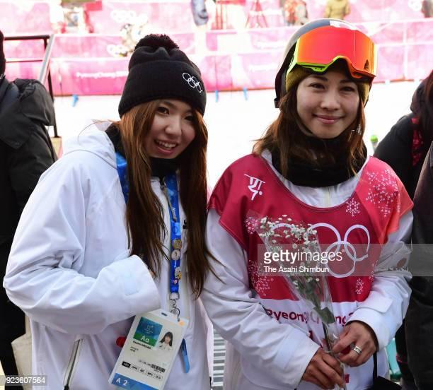 Asami Hirono and Yuka Fujimori of Japan pose for photographs after the Snowboard Ladies' Big Air Final on day thirteen of the PyeongChang Winter...