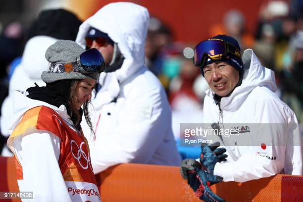 Asami Hirono of Japan talks with her coach in the Snowboard Ladies' Slopestyle Final on day three of the PyeongChang 2018 Winter Olympic Games at...