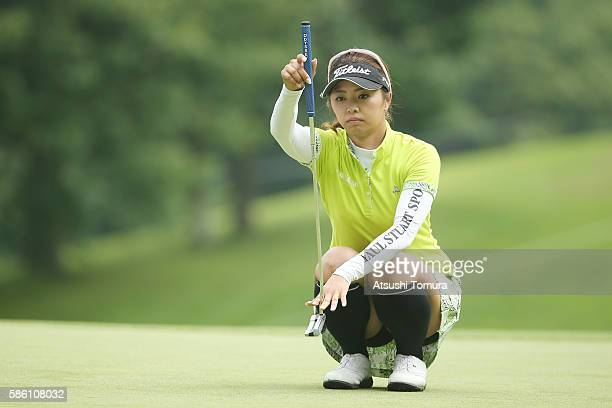 Asami Kikuchi of Japan lines up her putt on the 7th green during the first round of the meiji Cup 2016 at the Sapporo Kokusai Country Club on July 31...