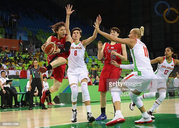 Asami Yoshida of Japan drives the ball past Yelena Leuchanka of Belarus during a Women's Basketball Preliminary Round game on Day 1 of the Rio 2016...