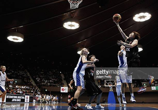 Asami Yoshida of Japan goes for a layup during the women's basketball friendly match between Japan and Slovakia at Yoyogi Gymnasium on May 21 2012 in...