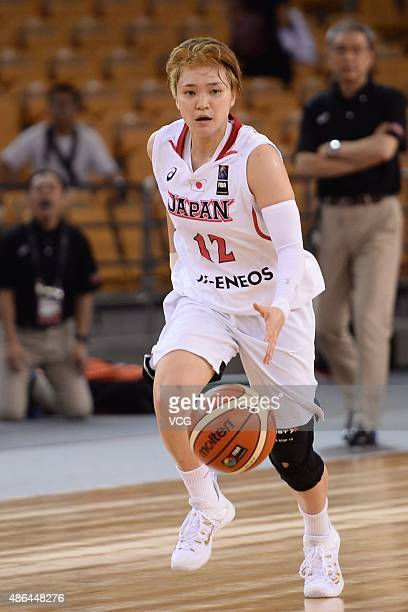 Asami Yoshida of Japan handles the ball in semifinal match between Japan and Chinese Taipei during the 2015 FIBA Asia Championship for Women at Wuhan...