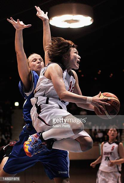 Asami Yoshida of Japan scores the winning basket in overtime during the women's basketball friendly match between Japan and Slovakia at Yoyogi...