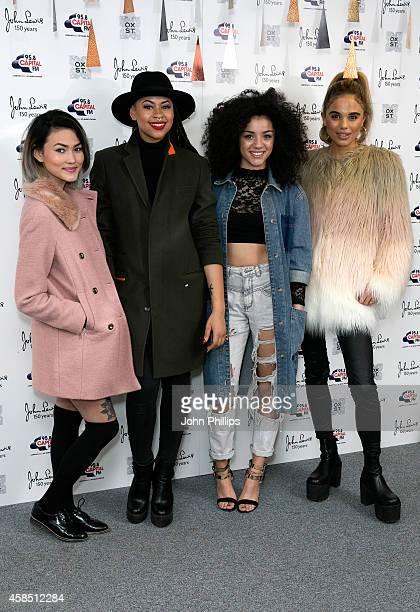 Asami Zdrenka Amira McCarthy Shereen Cutkelvin and Jess Plummer of Neon Jungle attend The World Famous Oxford Street Christmas Lights Switch On Event...