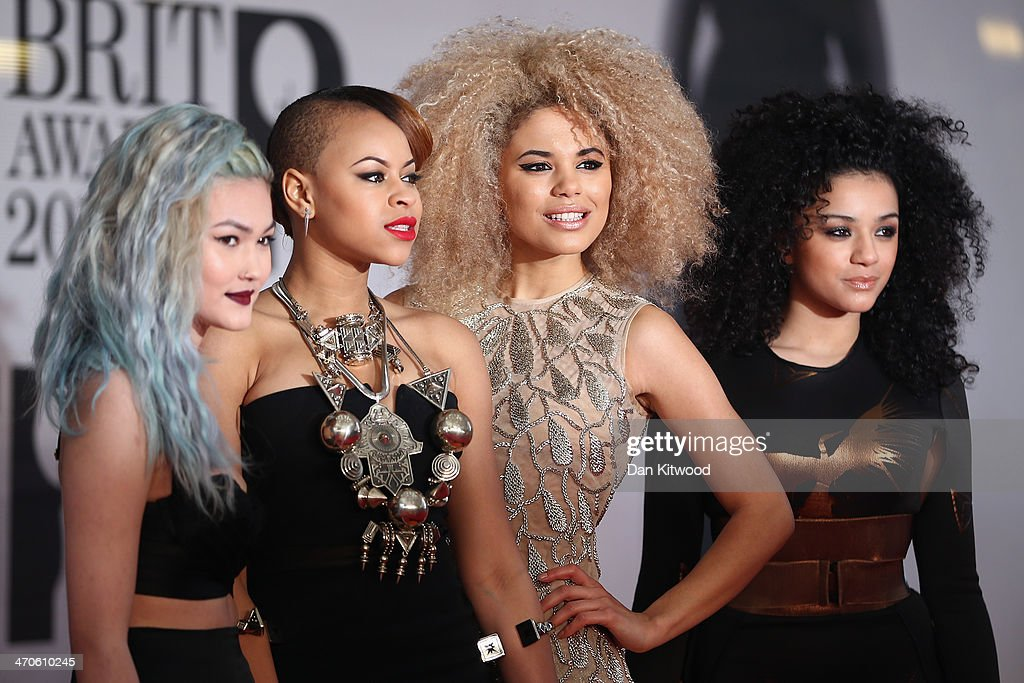 Asami Zdrenka, Amira McCarthy, Shereen Cutkelvin and Jess Plummer of Neon Jungle attend The BRIT Awards 2014 at 02 Arena on February 19, 2014 in London, England.