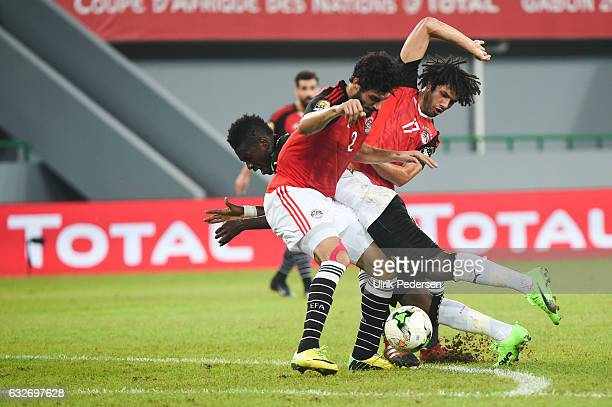 Asamoah Gyan of Ghana Ali Gabr and Mohamed Elneny of Egypt during the African Nations Cup match between Egypt and Ghana on January 25 2017 in Port...