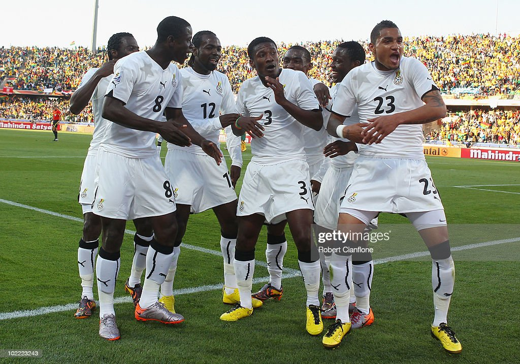 Asamoah Gyan of Ghana (#3) celebrates scoring a penalty with team mates during the 2010 FIFA World Cup South Africa Group D match between Ghana and Australia at the Royal Bafokeng Stadium on June 19, 2010 in Rustenburg, South Africa.