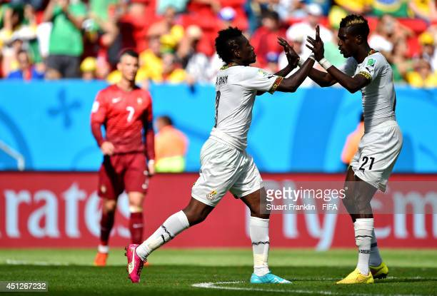 Asamoah Gyan of Ghana celebrates scoring his team's firs goal with his teammate John Boye during the 2014 FIFA World Cup Brazil Group G match between...