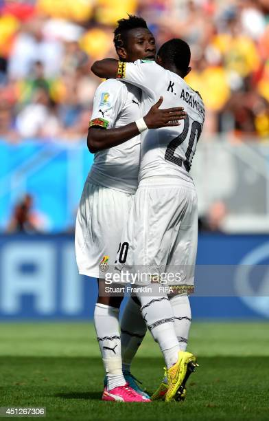 Asamoah Gyan of Ghana celebrates scoring his team's firs goal with his teammate Kwadwo Asamoah during the 2014 FIFA World Cup Brazil Group G match...