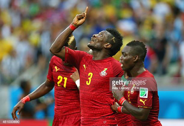 Asamoah Gyan of Ghana celebrates scoring his team's second goal with his teammates Christian Atsu and John Boye of Ghana during the 2014 FIFA World...