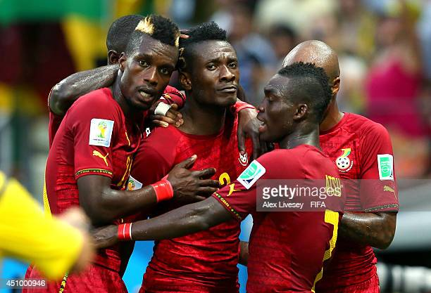 Asamoah Gyan of Ghana celebrates scoring his team's second goal with his teammates Christian Atsu and John Boye during the 2014 FIFA World Cup Brazil...