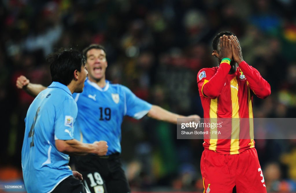 Asamoah Gyan of Ghana covers his face in shock after he hits a penalty kick onto the crossbar after Luis Suarez of Uruguay handles the ball off the line and is sent off during the 2010 FIFA World Cup South Africa Quarter Final match between Uruguay and Ghana at the Soccer City stadium on July 2, 2010 in Johannesburg, South Africa.