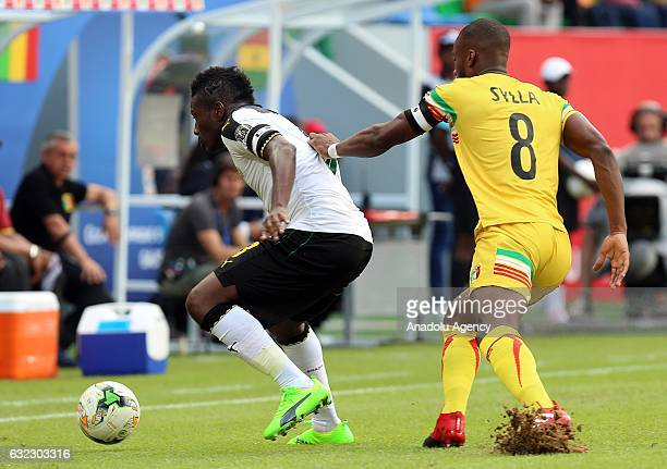Asamoah Gyan of Ghana in action against Yacouba Sylla of Mali during the African Cup of Nations 2017 Group D football match between Ghana and Mali at...