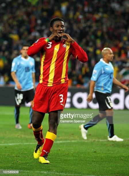 Asamoah Gyan of Ghana reacts as he misses a late penalty kick in extra time to win the match during the 2010 FIFA World Cup South Africa Quarter...