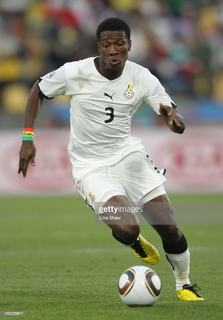 Asamoah Gyan of Ghana runs with the ball during the 2010 FIFA World Cup South Africa Group D match between Ghana and Australia at the Royal Bafokeng Stadium on June 19, 2010 in Rustenburg, South Africa.