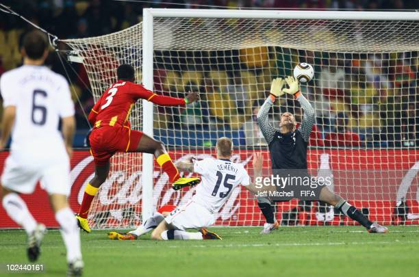 Asamoah Gyan of Ghana scores his side's second goal past Tim Howard of the United States during the 2010 FIFA World Cup South Africa Round of Sixteen...