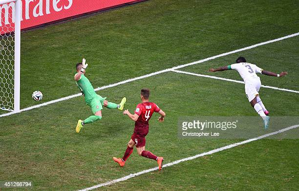 Asamoah Gyan of Ghana scores his team's first goal past goalkeeper Beto of Portugal during the 2014 FIFA World Cup Brazil Group G match between...
