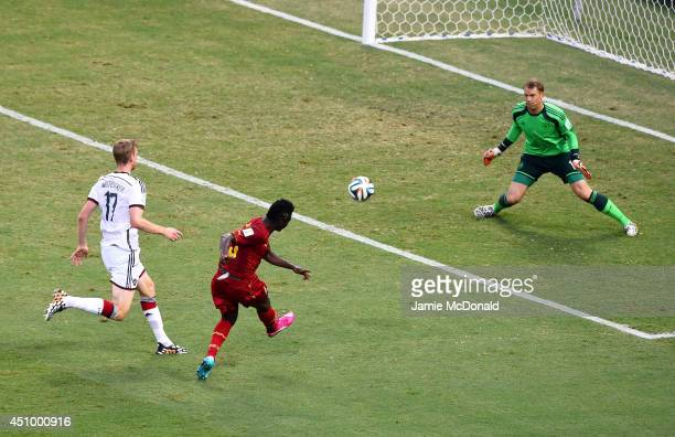 Asamoah Gyan of Ghana scores his team's second goal past Manuel Neuer of Germany during the 2014 FIFA World Cup Brazil Group G match between Germany...