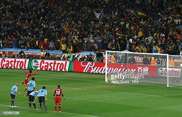 Asamoah Gyan of Ghana shoots his penalty onto the crossbar after Luis Suarez of Uruguay handles the ball off the line and is sent off during the 2010...