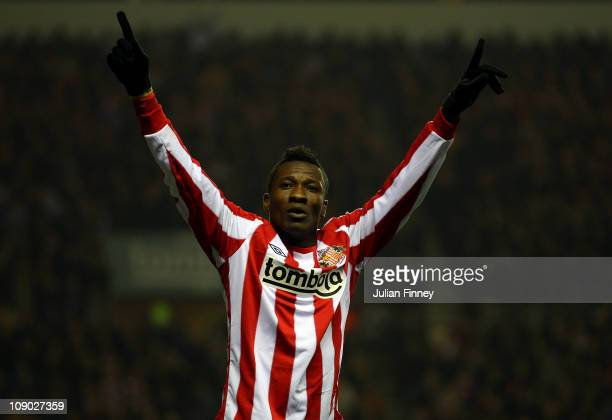 Asamoah Gyan of Sunderland celebrates scoring the first goal during the Barclays Premier League match between Sunderland and Tottenham Hotspur at the...