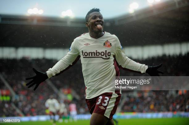 Asamoah Gyan of Sunderland celebrates scoring to make it 2-1 during the Barclays Premier League match between Stoke City and Sunderland at the...
